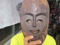 palawan wood carvings person holding mask